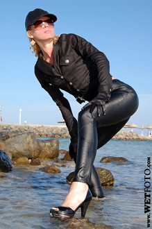 #1 - Wetlook by Sexy Blonde Girl in Black Jacket and Leggings by the Sea