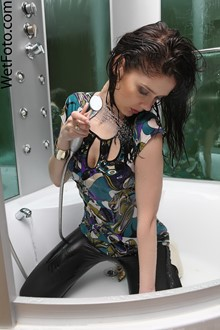 #102 - Brunette Girl in Black Leggings, Blouse and High Heels Get Fully Wet in Jacuzzi