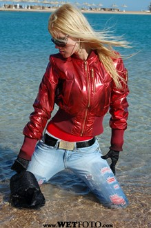 #11 - Wet Girl in Red Jacket, Tight Jeans and High Heels by the Sea