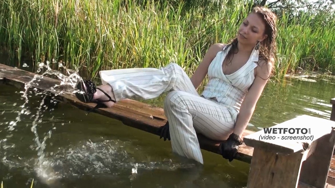 wet girl get wet wet hair swim fully clothed top pants high heels lake