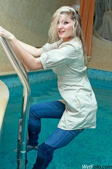 #139 - Wetlook by Blonde Girl in Jacket, Y-Shirt, Tight Jeans and Shoes in Pool