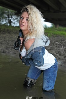 #150 - Wetlook by Dirty Girl in Jacket, Tight Jeans and Leather Jackboots by the River