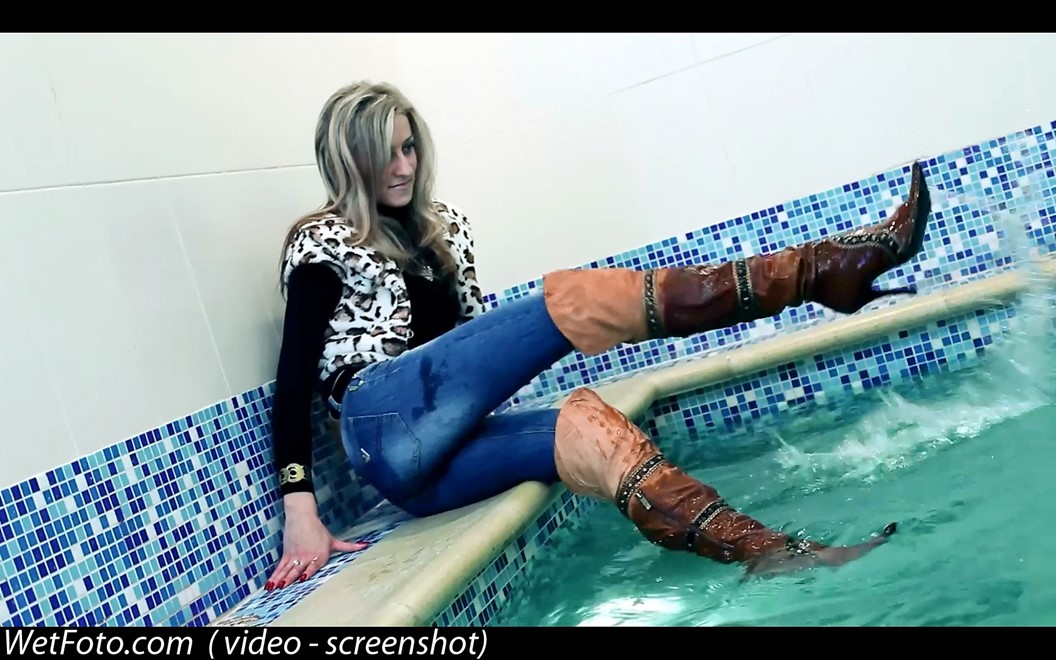 wet girl get wet wet hair swim fully clothed vest sweater tight jeans jackboots pool