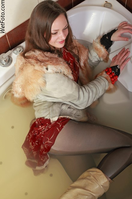 wet girl get wet wet hair fully clothed fur coat dress tights leather boots jacuzzi
