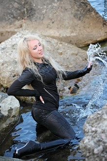 #187 - Wetlook by Cool Girl in Jacket, Black Leggings and High-Heeled Boots