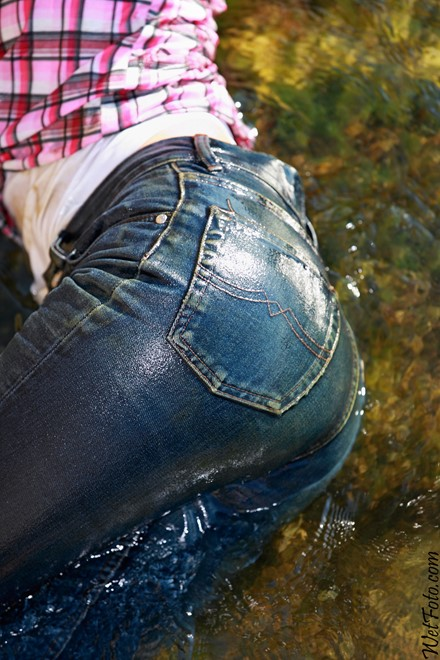 wet girl get wet wet hair swim fully clothed jeans shirt sea