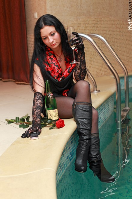 brunette wet woman wet hair get wet fully clothed dress stockings evening gloves leather high heels boots jacuzzi