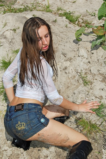 wet girl get wet wet hair fully clothed golf shorts denim leather jackboots lake