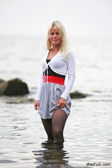 #221 - Wetlook by Sweet Blonde in Tights, Mini Dress and High Heels on Sea Shore