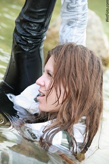 #225 - Wet Girl in Jacket, Leather Pants and High Heels on Lake