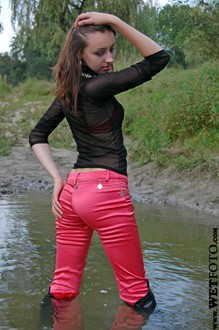 #23 - Wetlook by Beautiful Girl in Blouse, Pants and Leather Jackboots on Lake