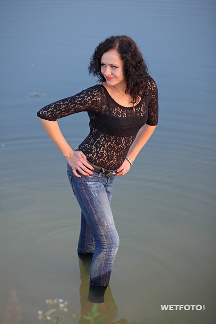 wet girl get wet fully clothed jeans blouse shoes high heels lake