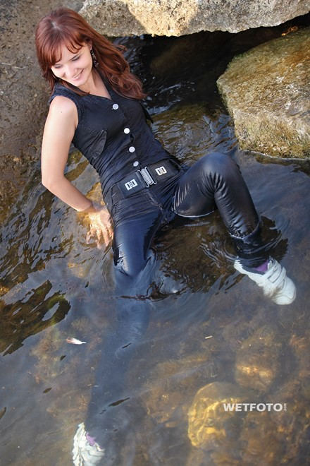 wet girl get wet wet hair fully clothed denim jumpsuit sneakers sea