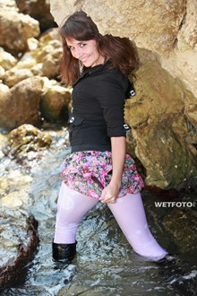 #246 - Fully Clothed Girl in Jacket, White Leggings and Leather Boots Get fully Wet at Sea