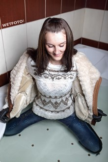 #255 - Wetlook by Brunette Girl in Wet Jacket, Tight Jeans and Sweater in Jacuzzi