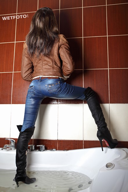 Wetlook By Brunette Girl In Wet Jacket Tight Jeans And