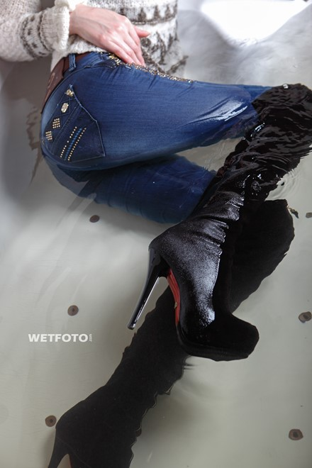 wet girl get wet wet hair fully clothed jacket sweater jeans high heels boots jacuzzi