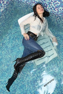 #261 - Wetlook with Beautiful Woman in Tight Jeans, Shirt and Leather Boots