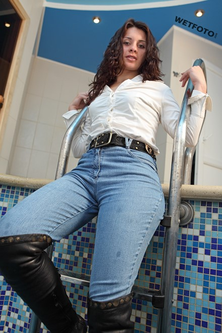 wet woman get wet wet hair jeans shirt boots leather high heels pool