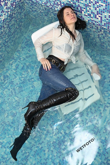 wetlook with beautiful woman in tight jeans  shirt and leather boots
