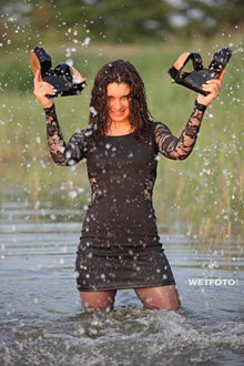 #266 - Wetlook by Curly Girl in Sexy Black Dress, Stockings and High Heels by the Lake