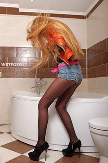 #277 - Wetlook by Long-Haired Girl in Leather Jacket, Denim Shorts, Tights and High Heels