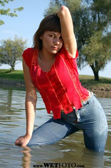 #29 - Wetlook by Cute Girl in Jeans, Blouse and Shoes with Heels on Lake