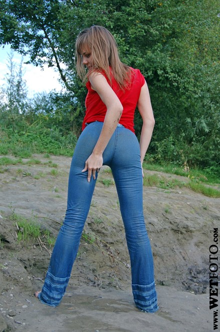 wet girl get wet wet hair fully clothed jeans blouse high heels shoes lake