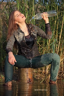 #298 - Wetlook by Dirty Girl in Denim Jacket, Tight Jeans and Boots