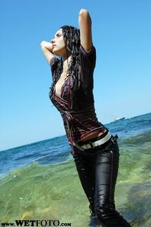 #3 - Wet Brunette Girl in Striped Blouse, Tight Pants and High Heels by the Sea