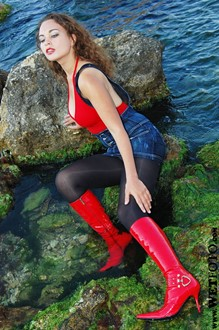#30 - Wetlook by Red-Haired Girl in Stockings and Red Leather Boots on Sea
