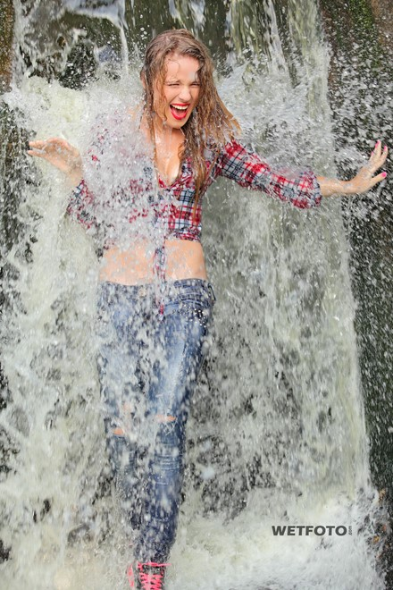 wet girl wet hair get wet shirt tight jeans sneakers water waterfall