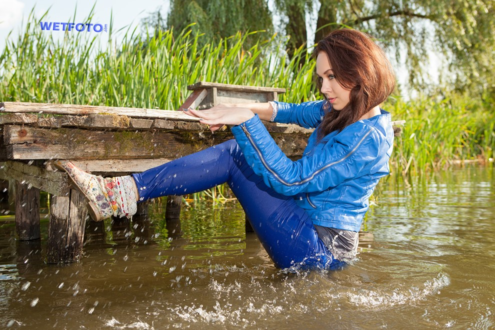 wet girl wet hair get wet leather jacket t-shirt tight pants tights swim fully clothed fully soaked lake
