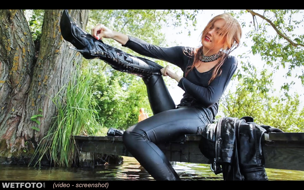 soaking wet girl in leather jacket leggings and leather