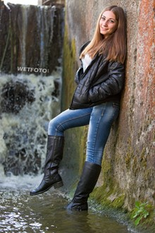 #339 - Fully Dressed Girl in Jacket, Jeans and Leather Boots Get Soaking Wet under Waterfall