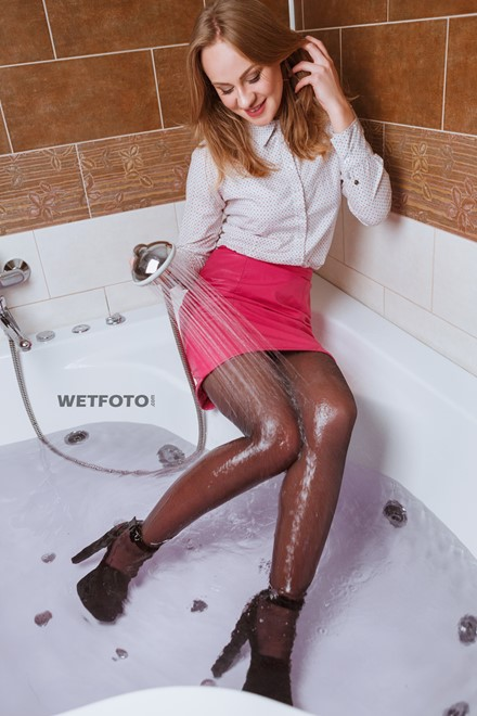 wet girl wet hair get wet blouse skirt stockings high heels fully soaked jacuzzi bath