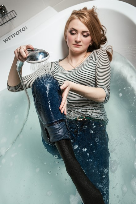 wet girl fully clothed get wet soaking wet striped sweater tight jeans boots high heels bath
