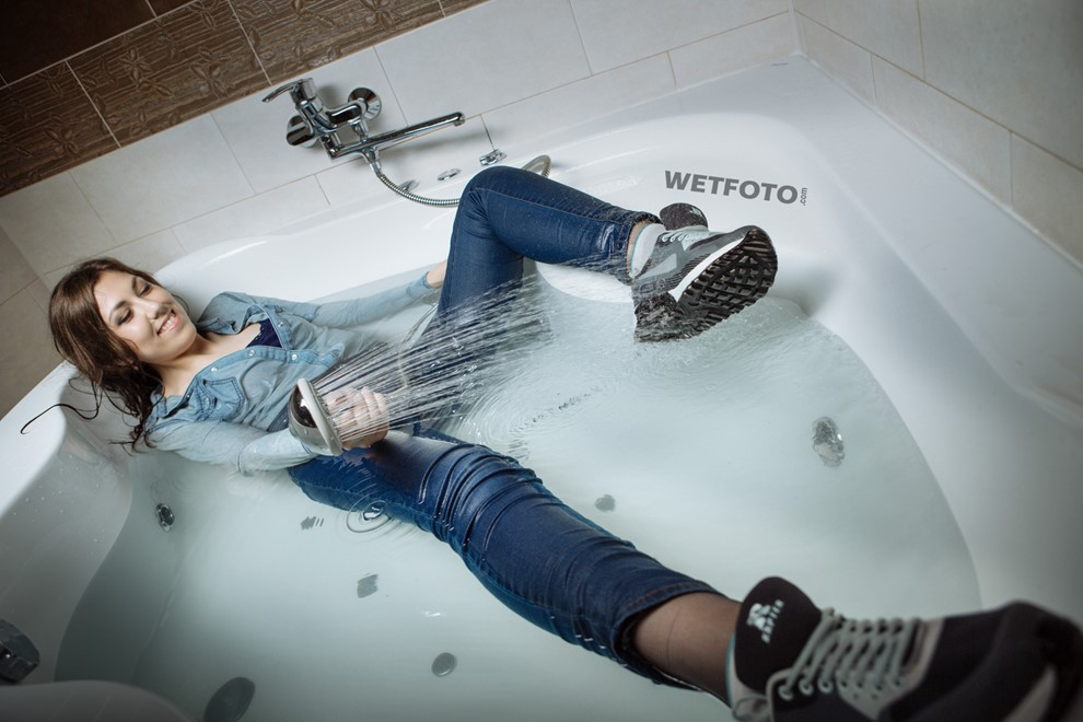 wet girl wet hair get wet fully clothed tights denim shirt tight jeans sneakers shower jacuzzi