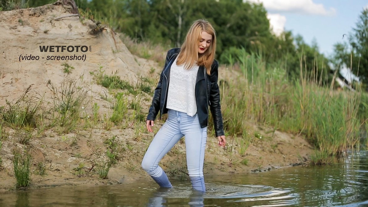 wet girl wet hair get wet swimming fully clothed tights leather jacket skinny jeans lake