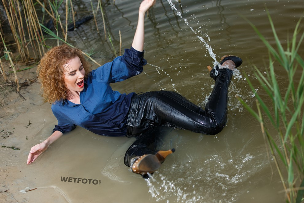 wet girl wet hair get wet swimming fully clothed shirt leather pants high heels lake