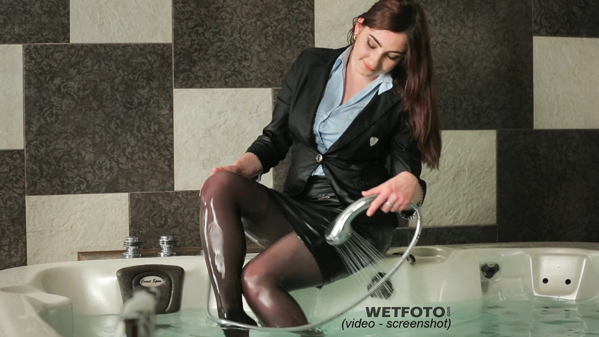 wetlook by pretty girl in business suit blouse and