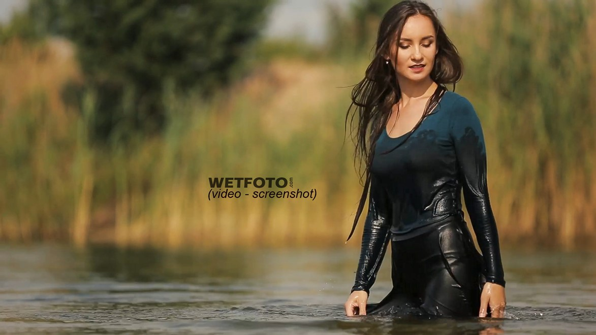 wet girl woman wet hair get wet soaked swim fully clothed skirt leather stockings blouse sneakers lake water