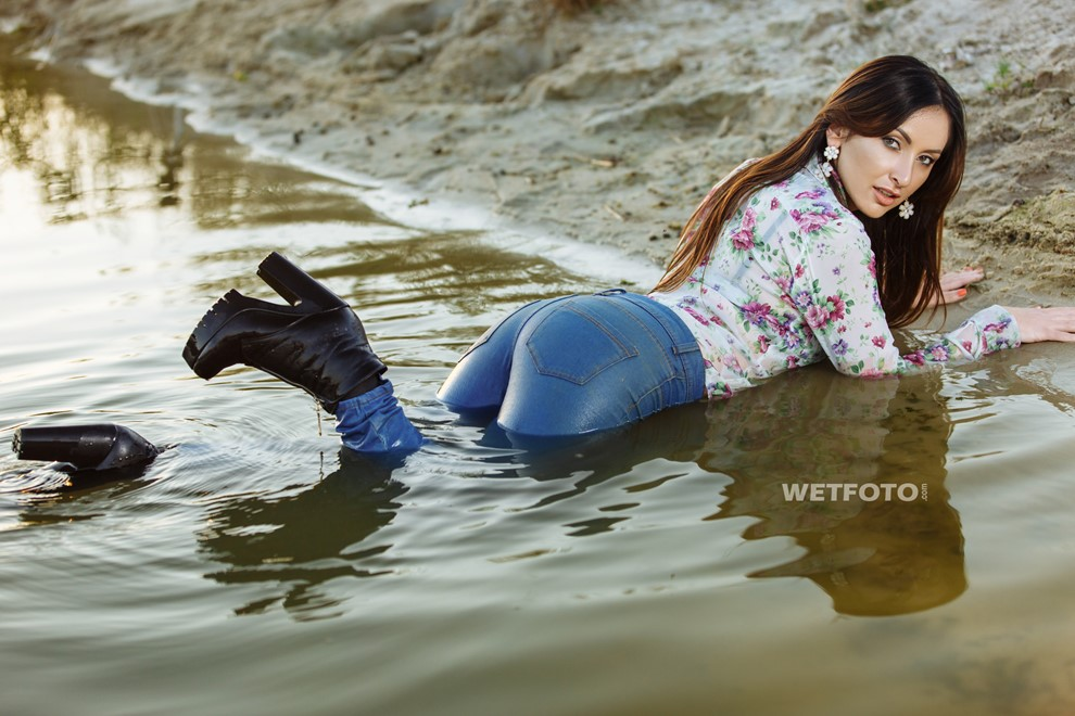wet girl woman wet hair get wet soaked swimming jeans t-shirt boots high heels lake