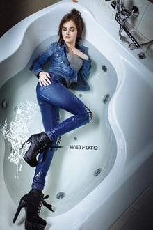 #384 - Fully Clothed Girl in Jacket, Jeans and Boots with High Heels Get Soaking Wet