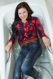 #387 - Wetlook by Happy Brunette Girl in Bright Shirt, Tight Jeans and Red Socks in Bath