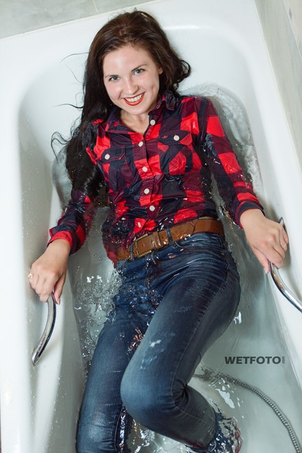 wet girl get wet soaking fully clothed jeans shirt socks wet hair bath