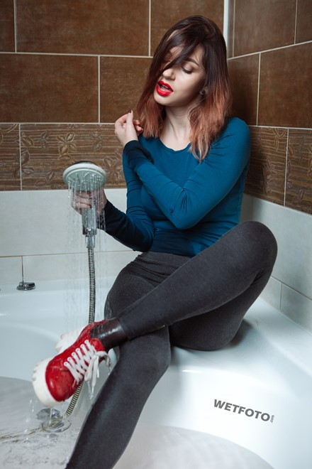 wet girl get wet photo soaking fully clothed bathroom sweater leggings tights shoes