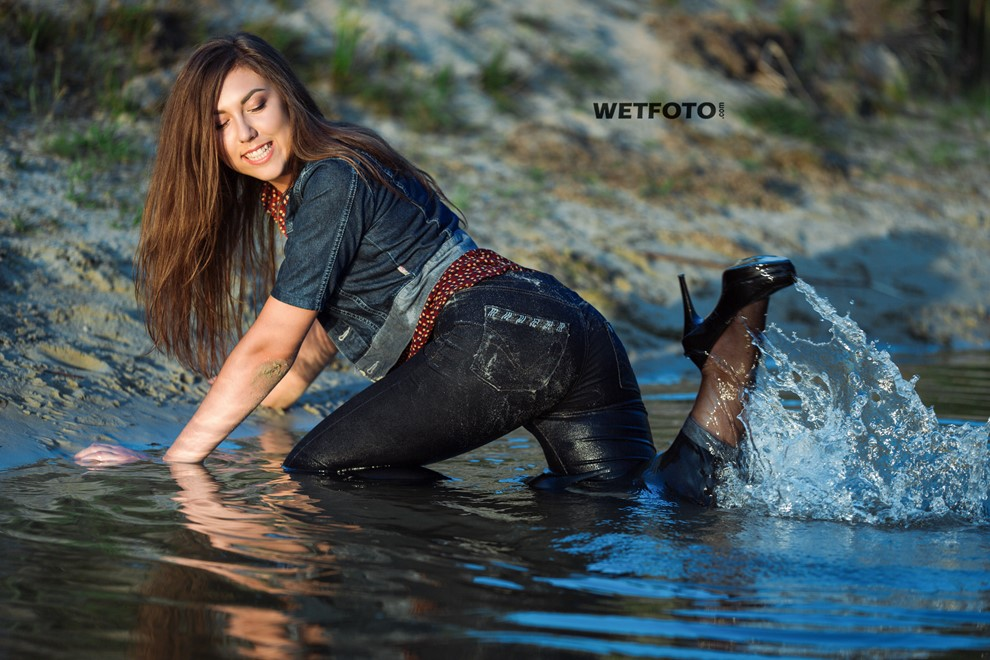 wet girl get wet photo soaked swim clothes skinny  jeans jacket blouse high heel shoes lake