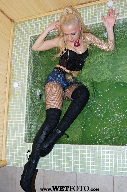 wet girl get wet wet hair fully clothed bustier denim shorts fishnet stockings jackboots high heels jacuzzi