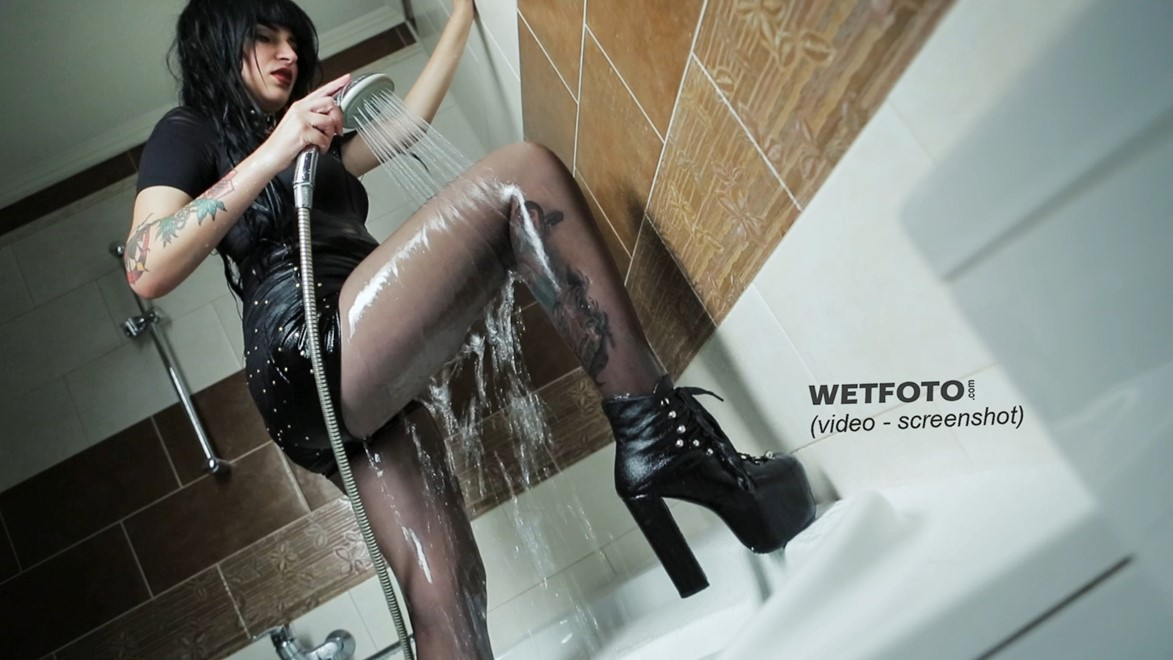 wet girl get wet tattoo fully clothed clothes stockings shorts high heels boots bath water